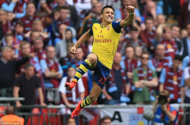 2934C3AD00000578-3103833-The_Gunners_striker_jumps_for_joy_in_front_of_the_disappointed_V-m-6_1433068675629